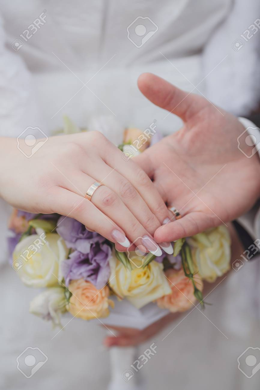 Hands And Rings It Is Beautiful Wedding Bouquet Stock Photo, Picture ...