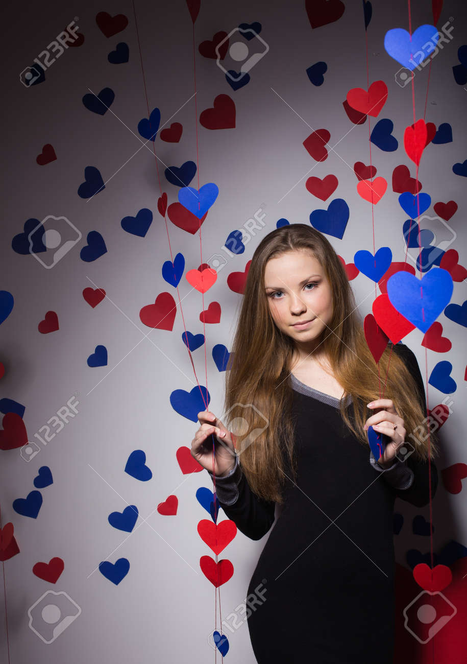 Valentine's Day. smiling woman with a gift in the form of heart Stock Photo - 25894253