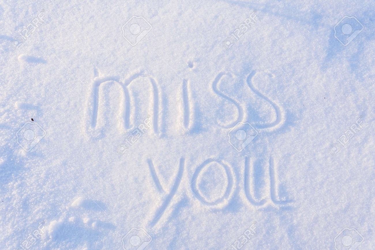 Miss you greetings written on wite snow stock photo picture and miss you greetings written on wite snow stock photo 48966781 m4hsunfo