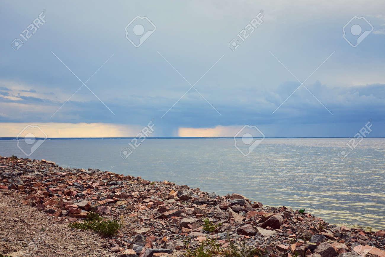 Storm and rain at Dead Sea coastline. Salt crystals at sunset. Texture of Dead sea. Salty sea shore - 169020531