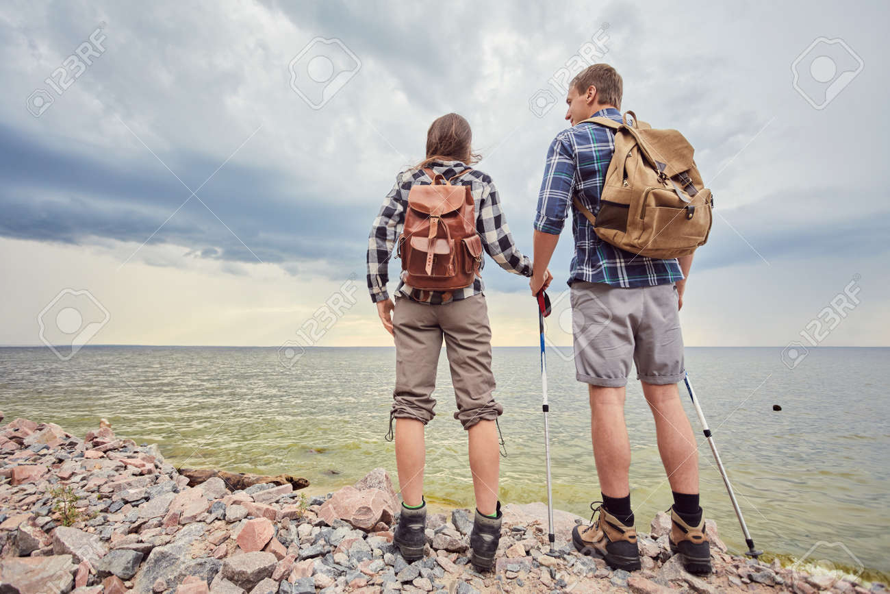 adventure, travel, tourism, hike and people concept - smiling couple with backpacks outdoors - 170687718