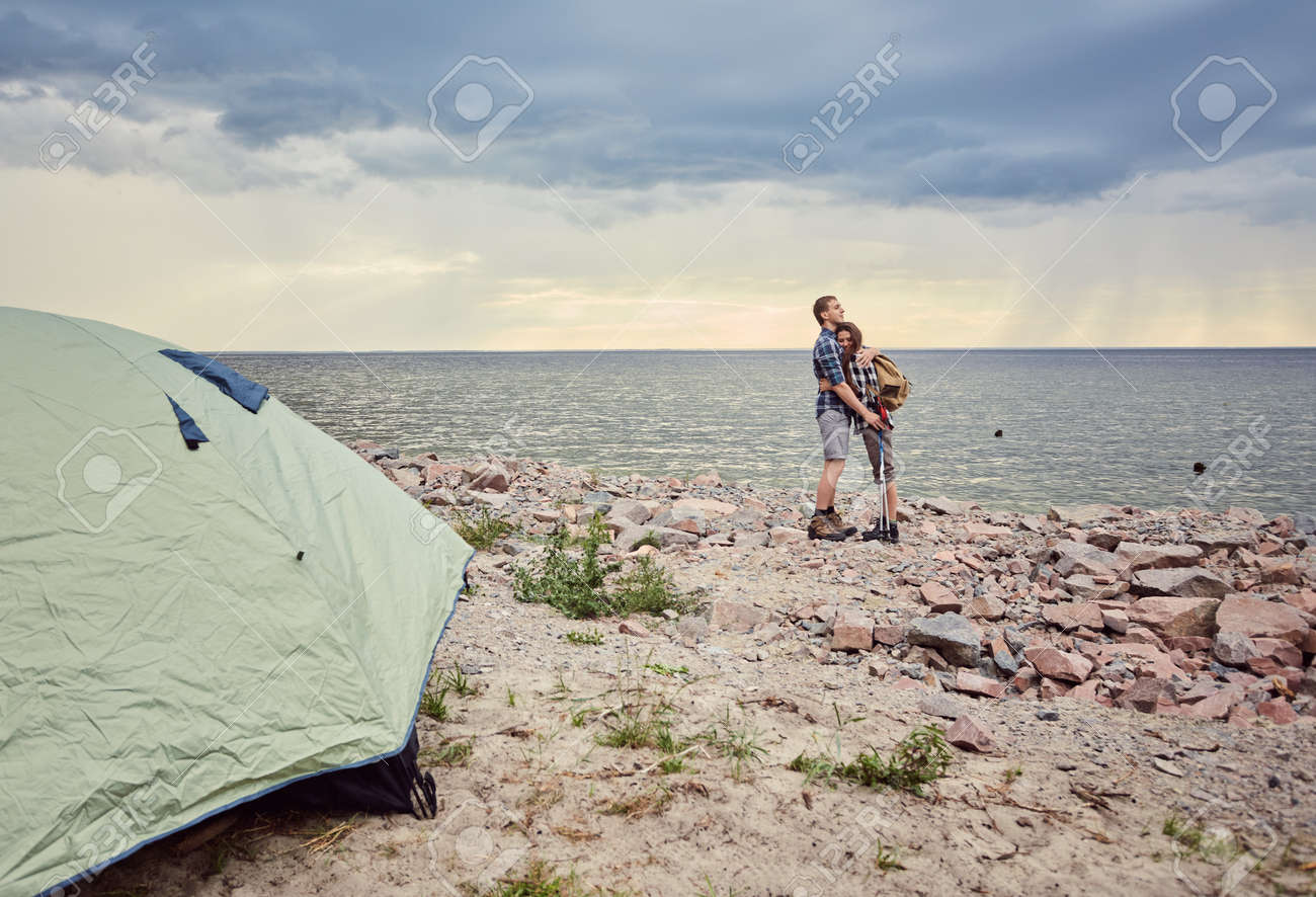 Happy couple with travel backpacks enjoying their summer vacation trip - 170687720