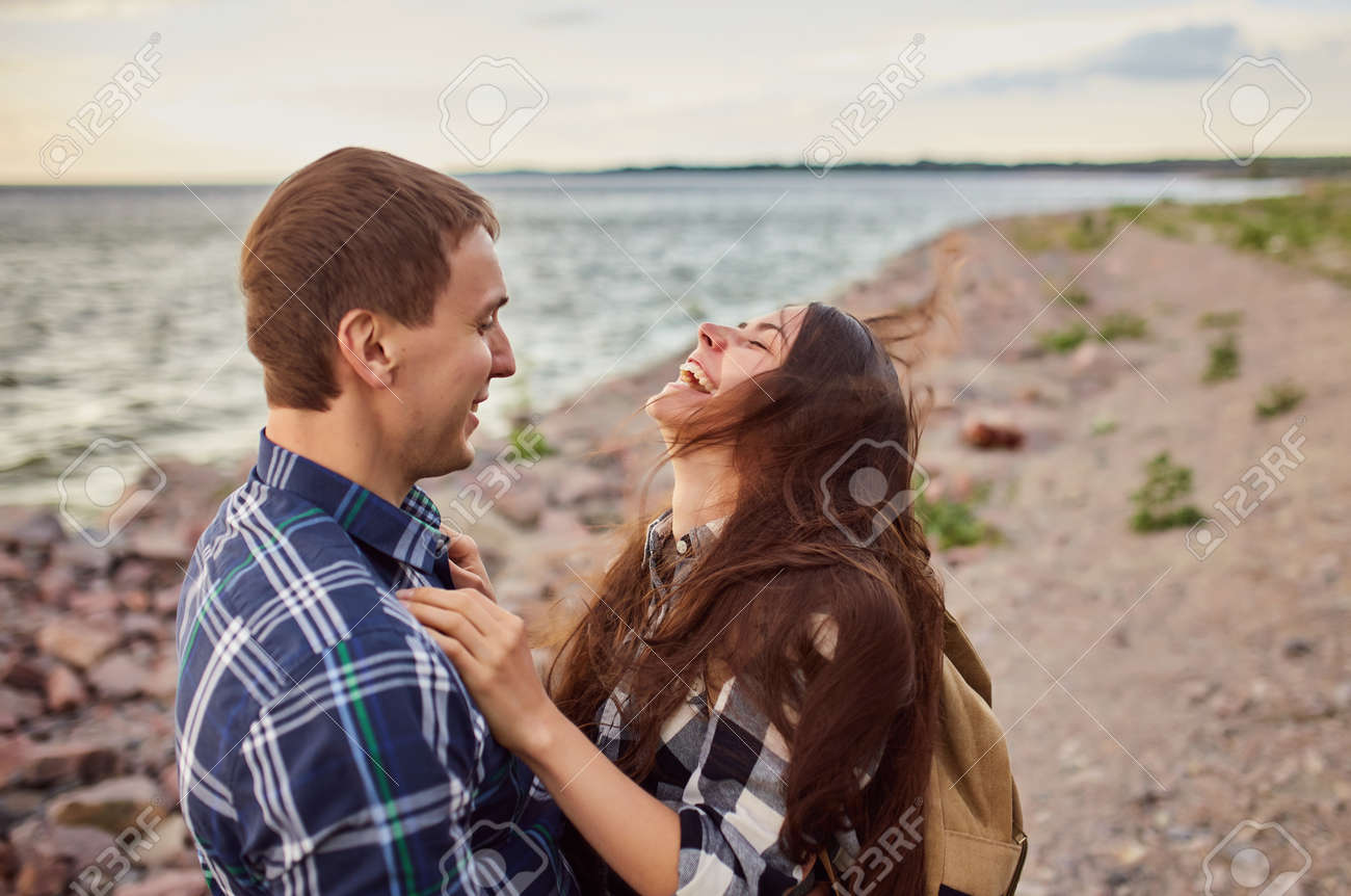 The happy couple running near the lake - 170687726