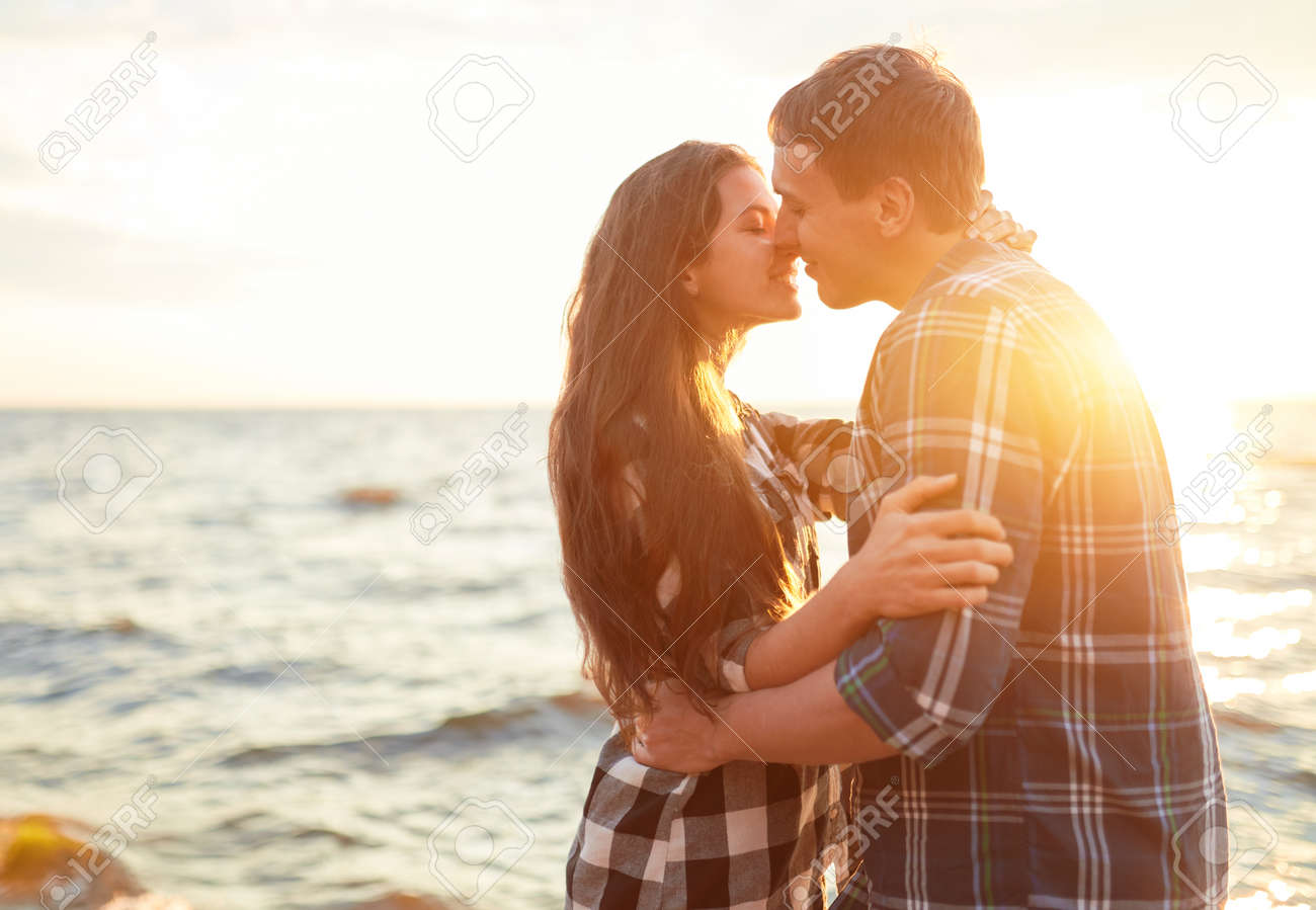 Happy couple at a lake in the countryside - 170687680