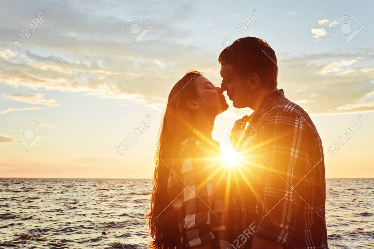 Couple in love silhouette during sunset- touching noses - 170687682