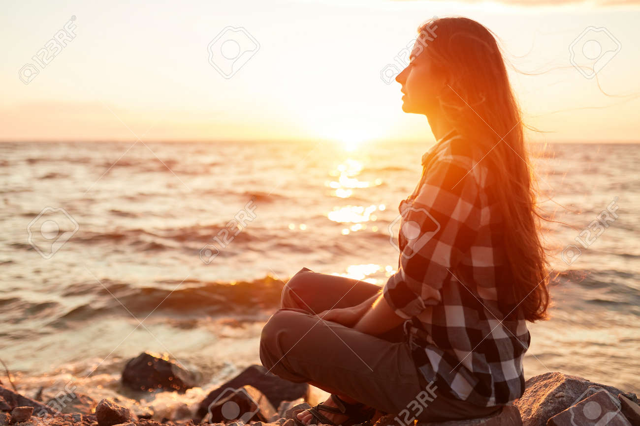 Portrait of young beautiful woman in sunset light - 170687692