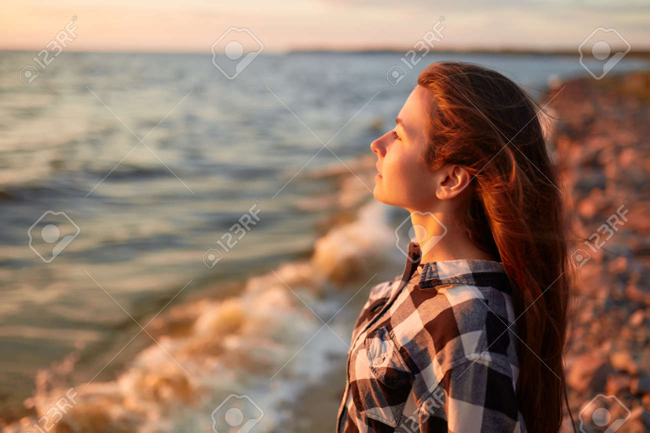 Portrait of young beautiful woman in sunset light - 170687610