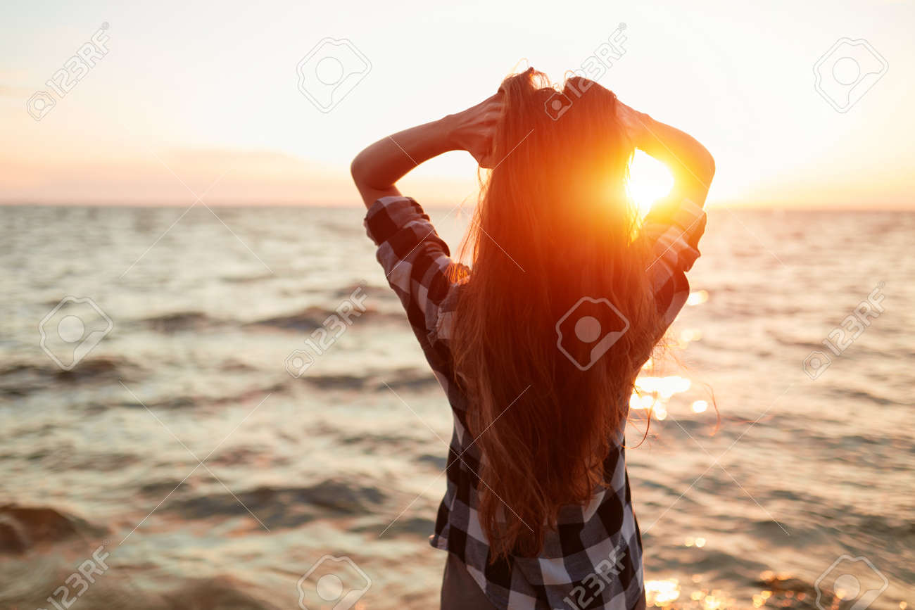 Portrait of young beautiful woman in sunset light - 170687604