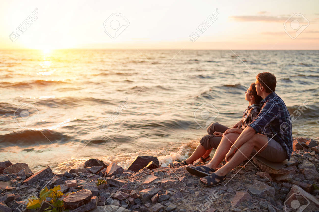 Happy couple at a lake in the countryside - 170687605