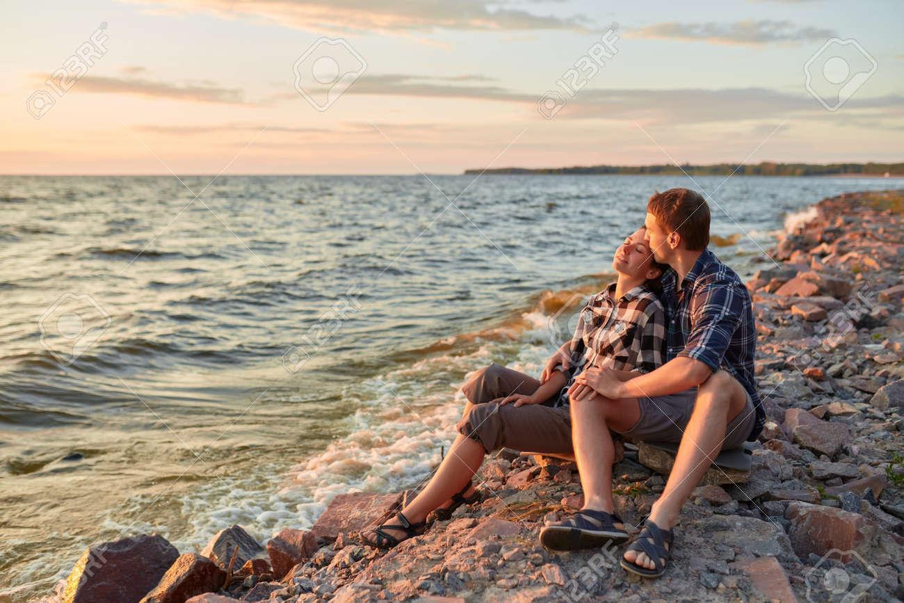 Young couple having fun on a sandy coast - 170687622