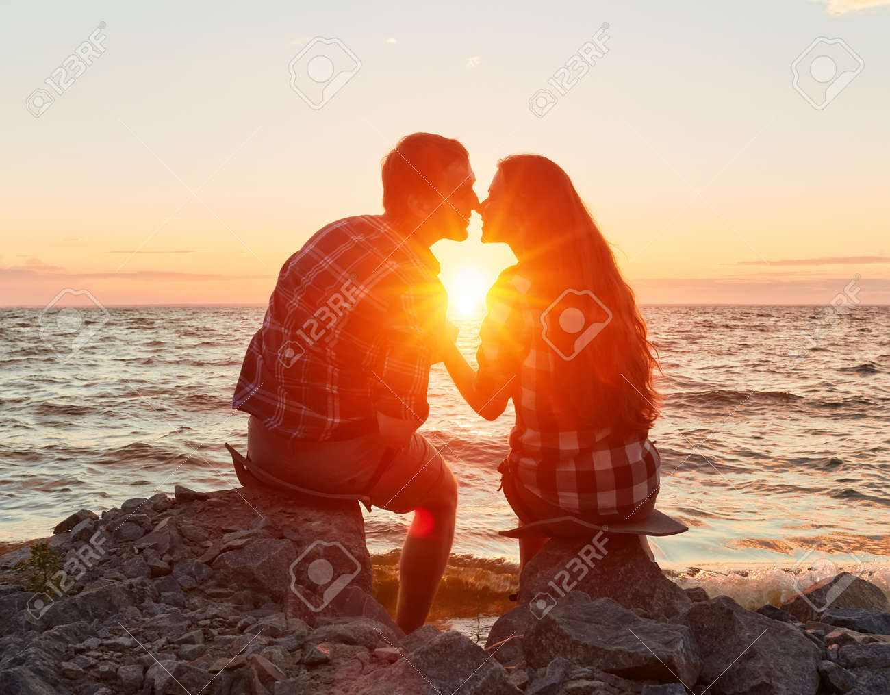 he and she on a nature outing. Romance and love.kiss in the sunset sun - 170687638