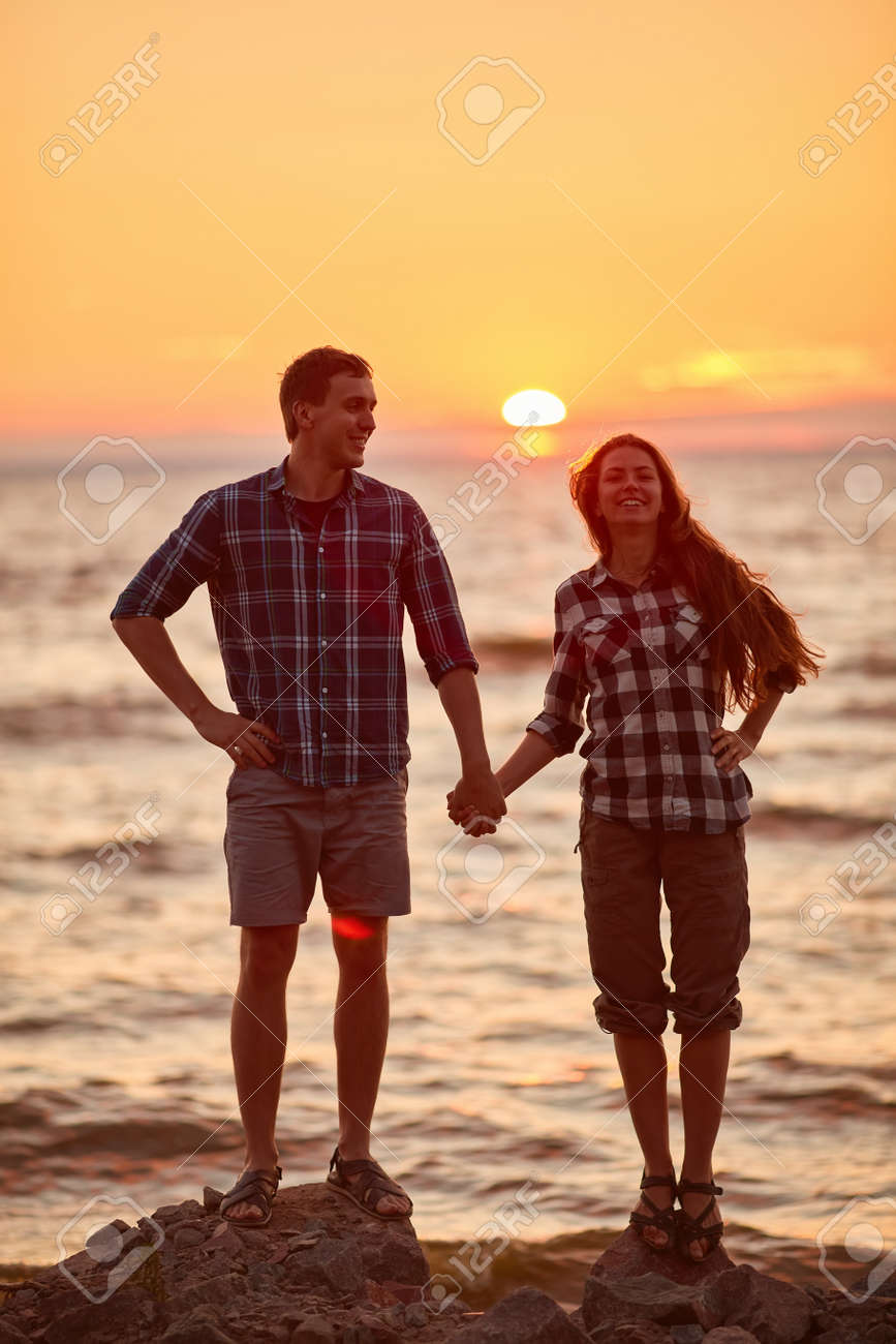 Happy couple at a lake in the countryside - 170687644