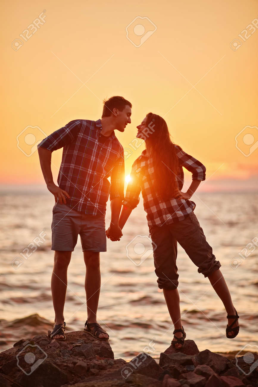 Happy couple at a lake in the countryside - 170687617