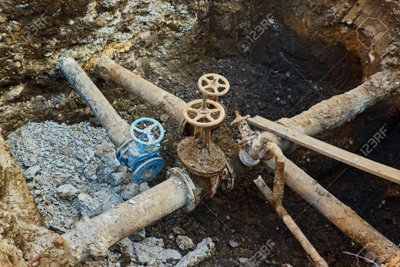 Old city water main taps, a hole dug to repair or replace water supply units - 169020789