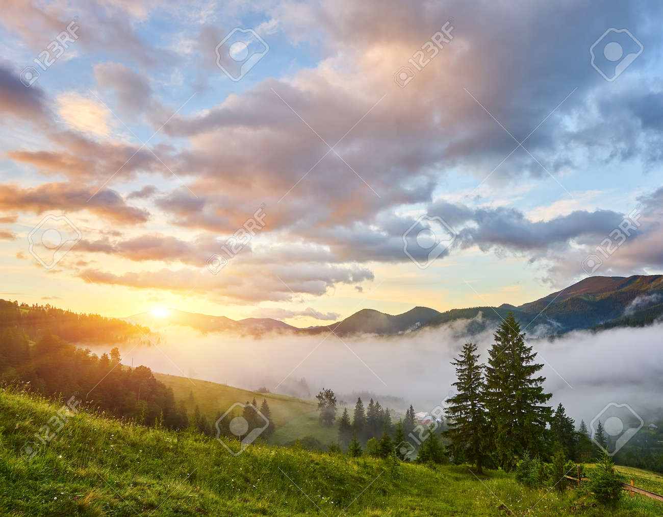 Summer landscape in mountains and the dark blue sky with clouds - 169020876