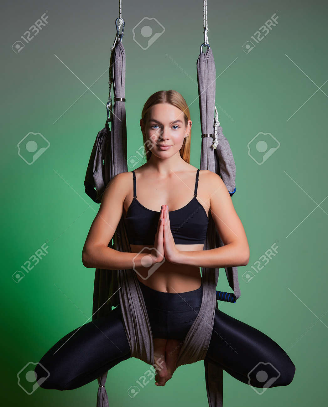 portrait young women making antigravity yoga exercises. Aerial aero fly fitness trainer workout. lotus. meditates. harmony and serenity concept - 169021157