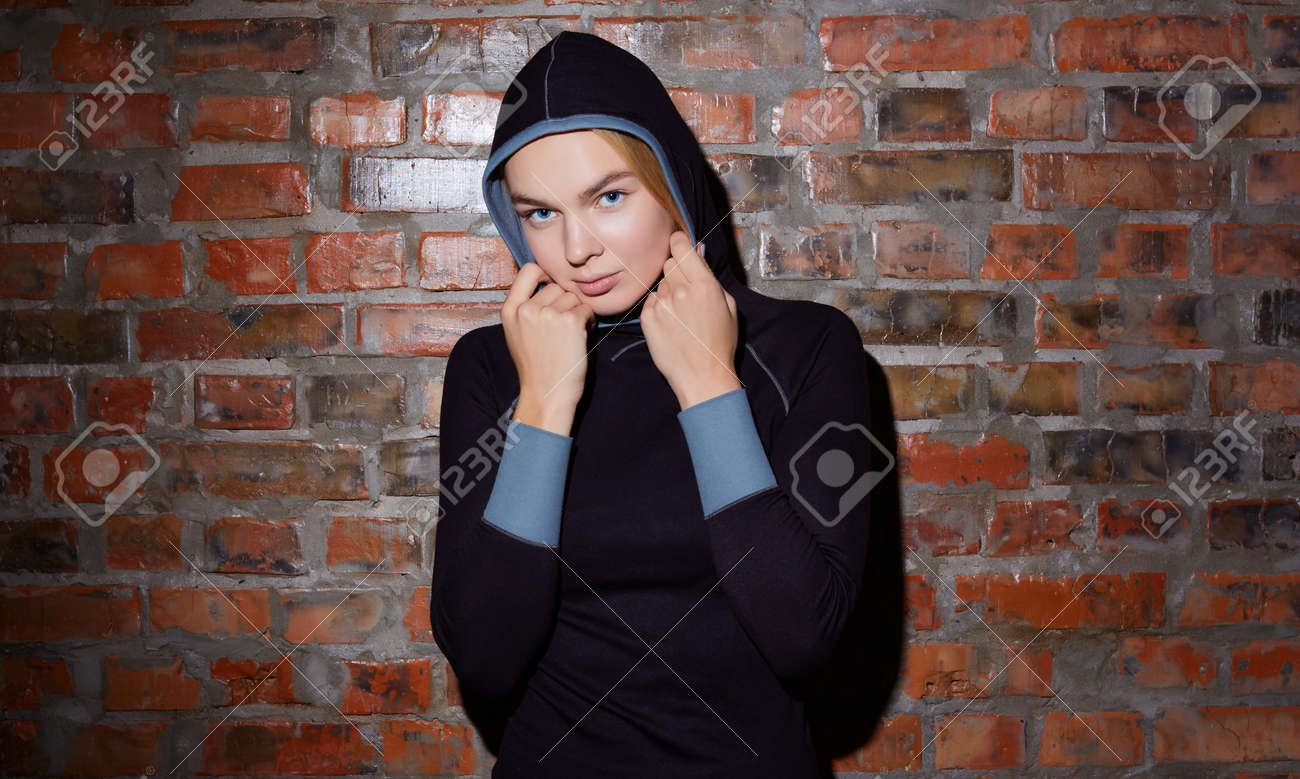sport and yoga lifestyle concept. Young fit pretty woman dressed in sport clothes poses against brick wall. - 169021336
