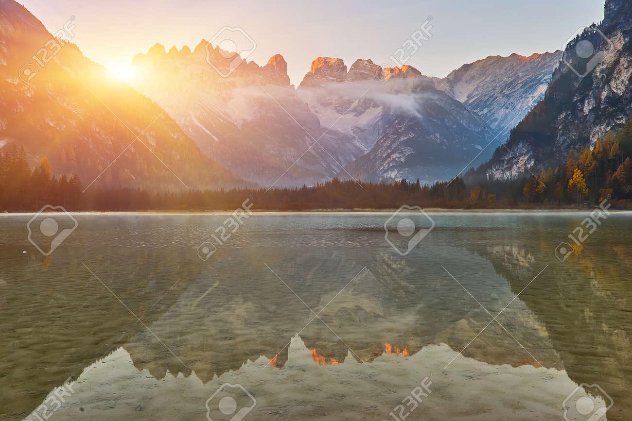 Sunrise at autumn mountain lake. Lago di Landro, Dolomites Alps, Italy - 172901672