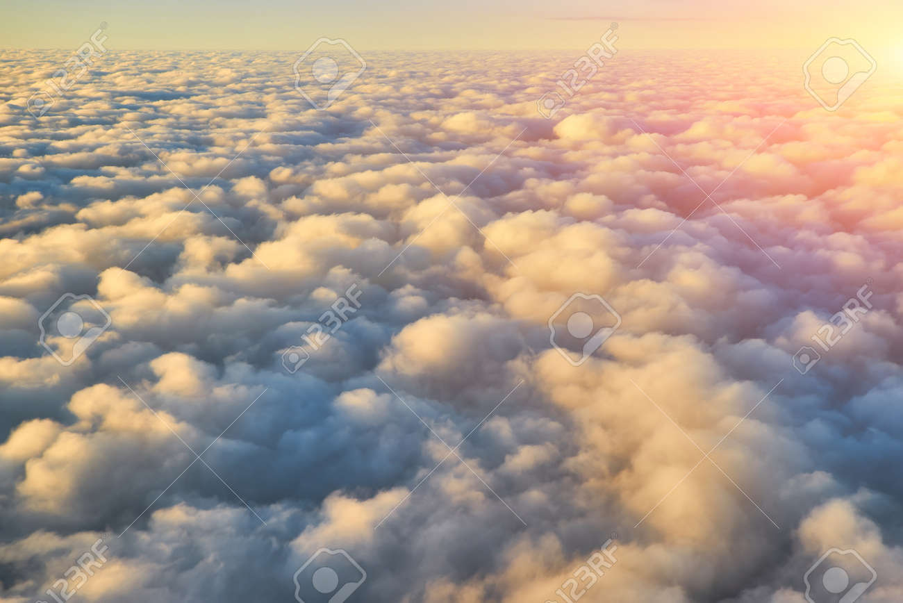 Spectacular view of a sunset above the clouds from airplane window - 172901292