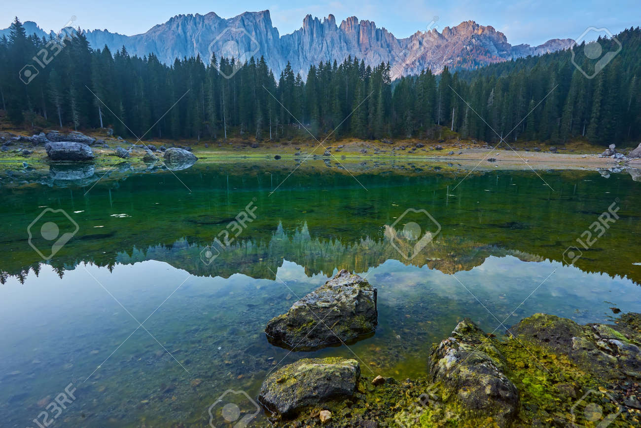 Carezza lake Lago di Carezza, Karersee with Mount Latemar, Bolzano province, South tyrol, Italy. Landscape of Lake Carezza or Karersee and Dolomites in background, Nova Levante, Bolzano, Italy. - 173010960