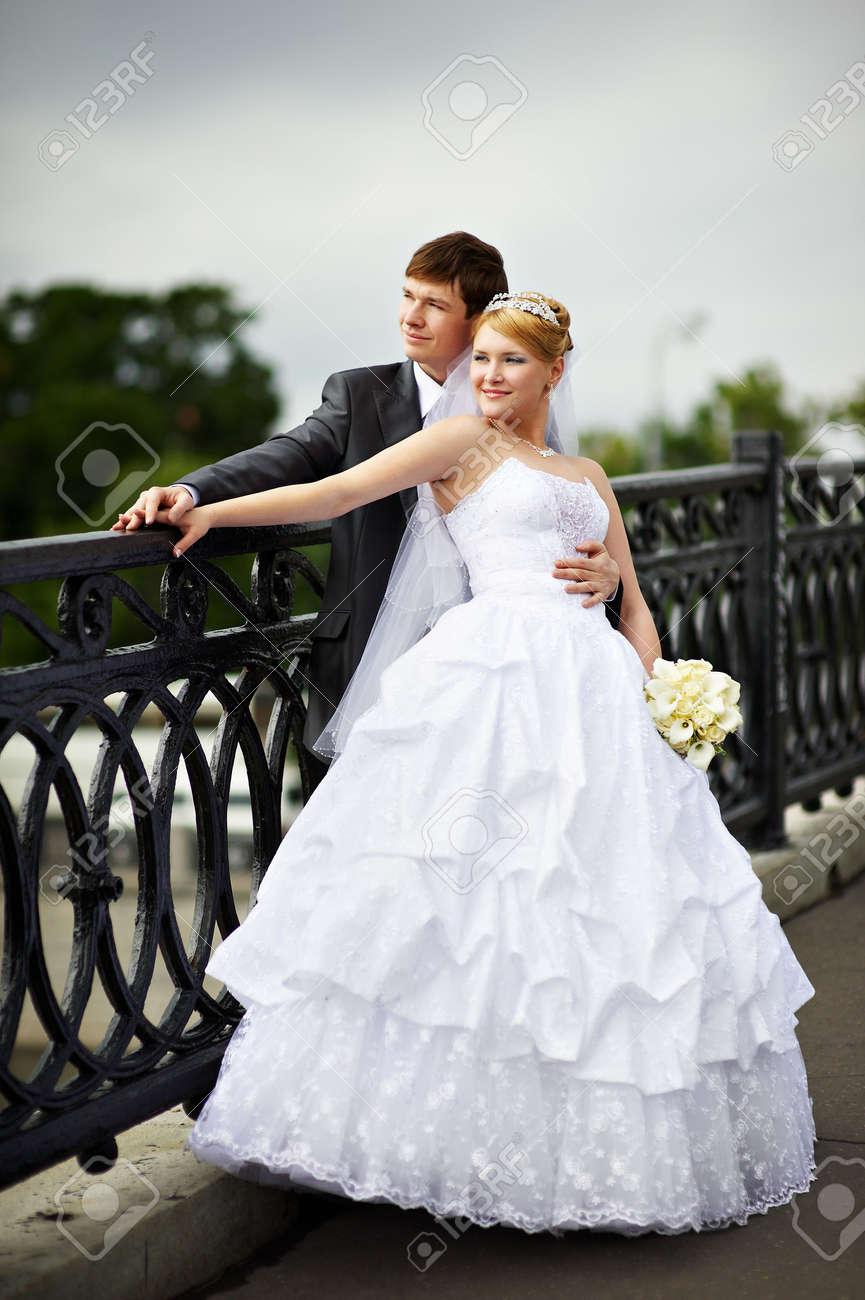 Happy bride and groom at a wedding a walk on bridge Stock Photo - 6506576