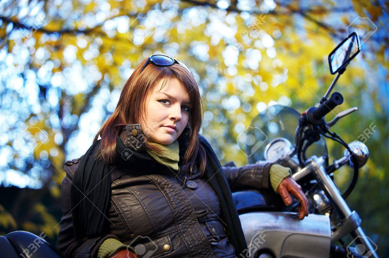Driving gloves girl - Stock Photo The Girl The Brunette About A Motorcycle In Autumn Park