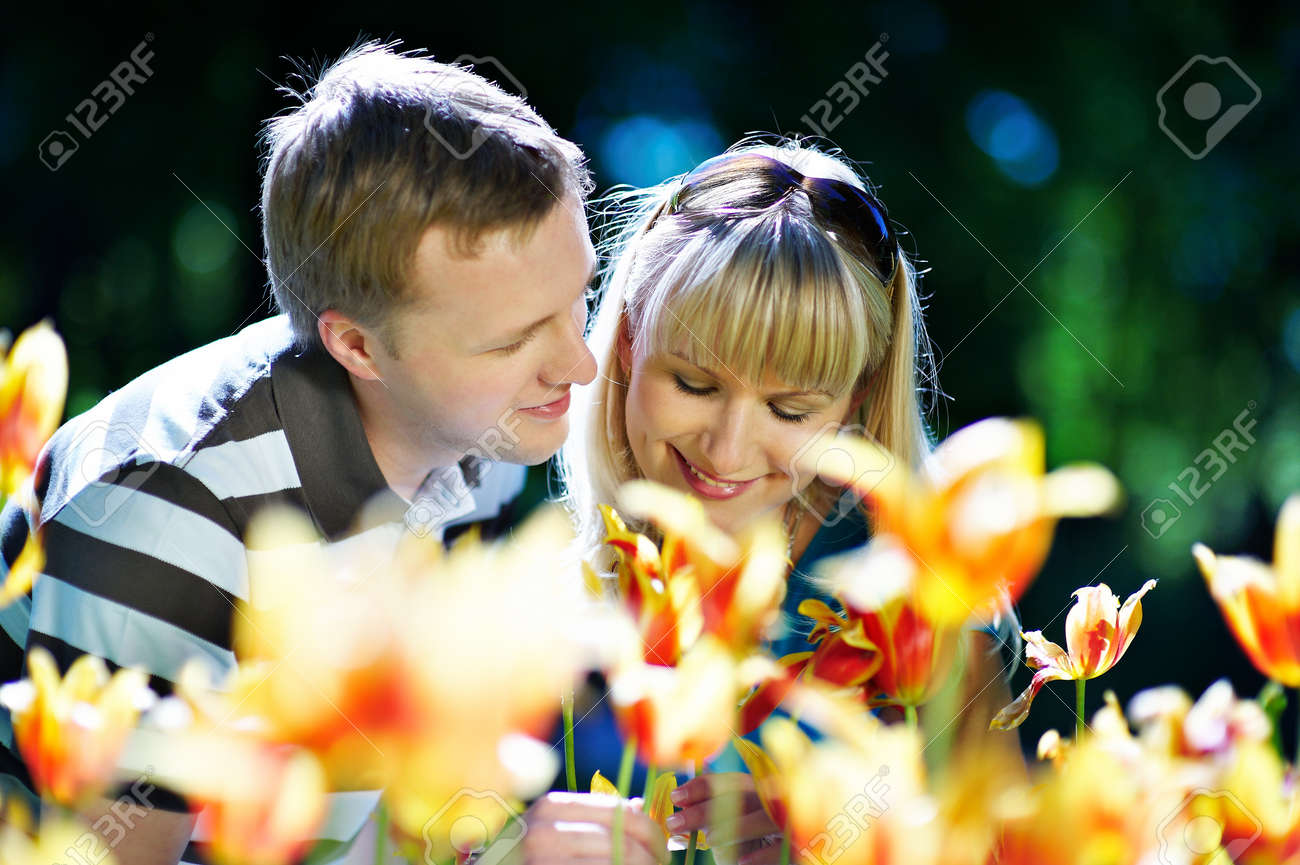 Happy woman and elegant man among flowers in spring park Stock Photo - 10697894