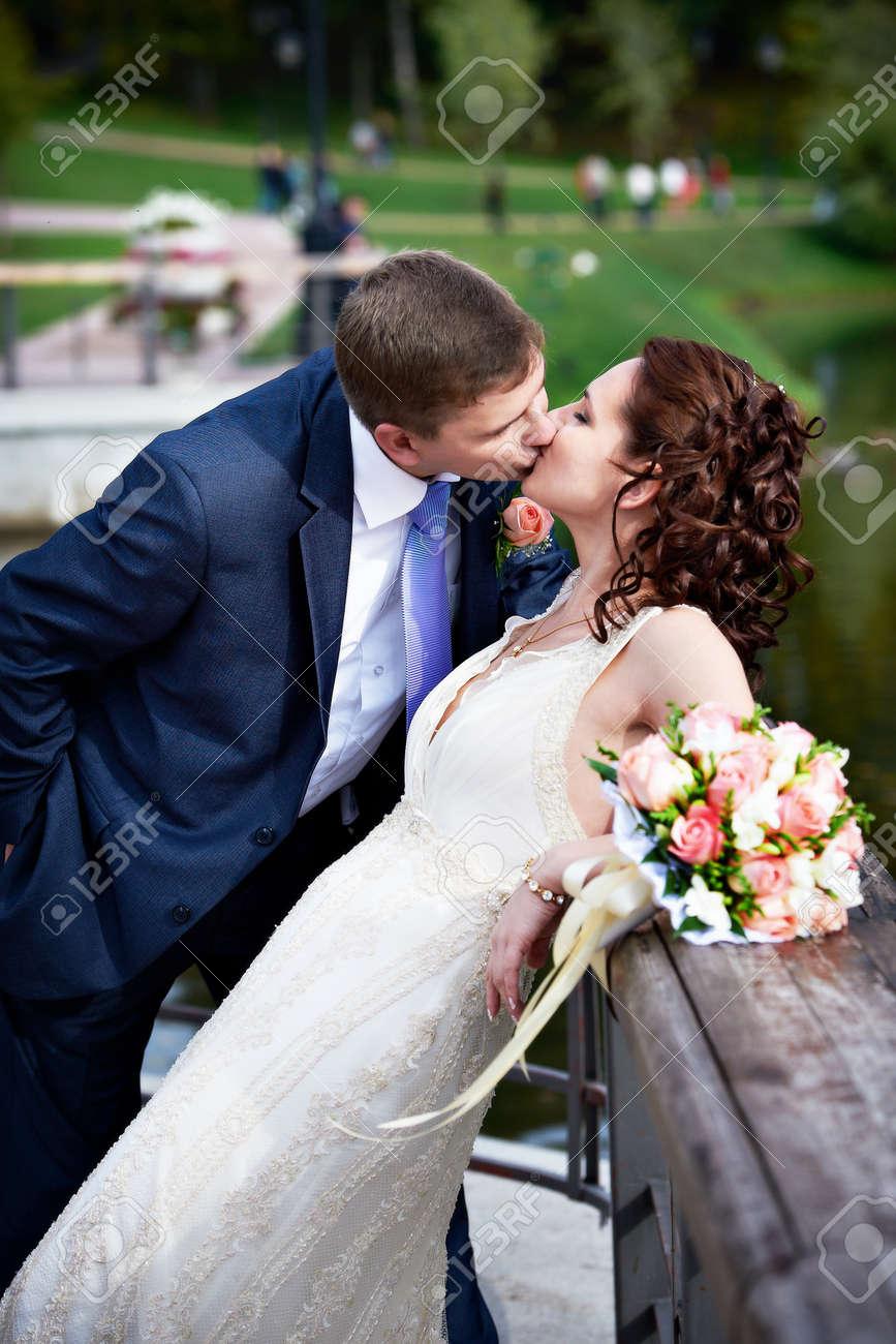 Romantic kiss bride and groom on wedding walk Stock Photo - 13758966