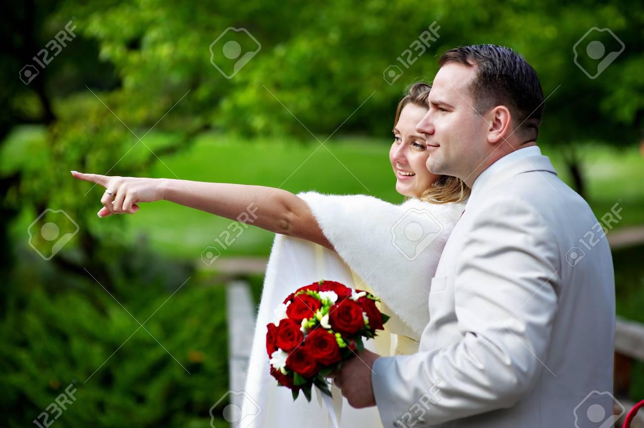 Happy bride and groom on wedding walk in park Stock Photo - 13842996
