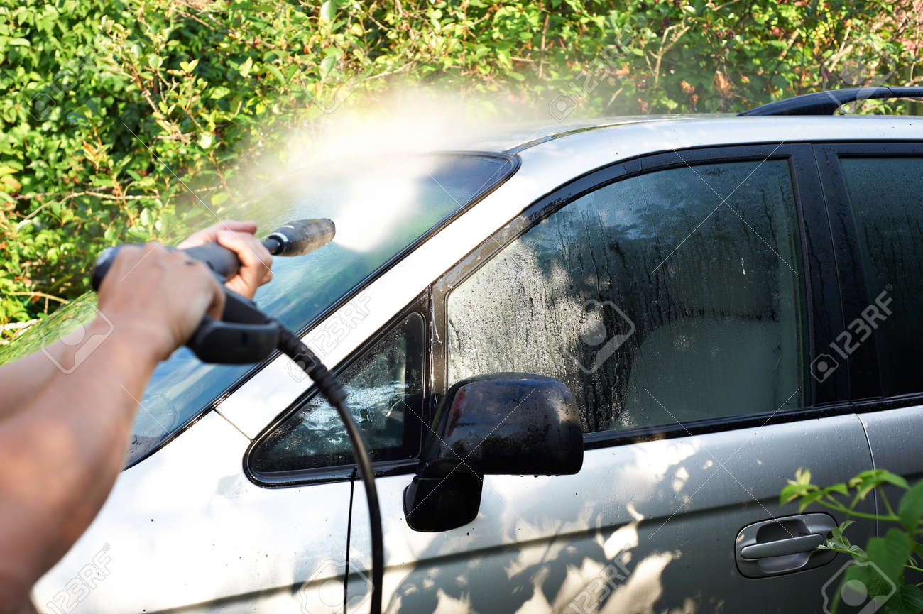 Washing car with pressured water outdoors Stock Photo - 15554776