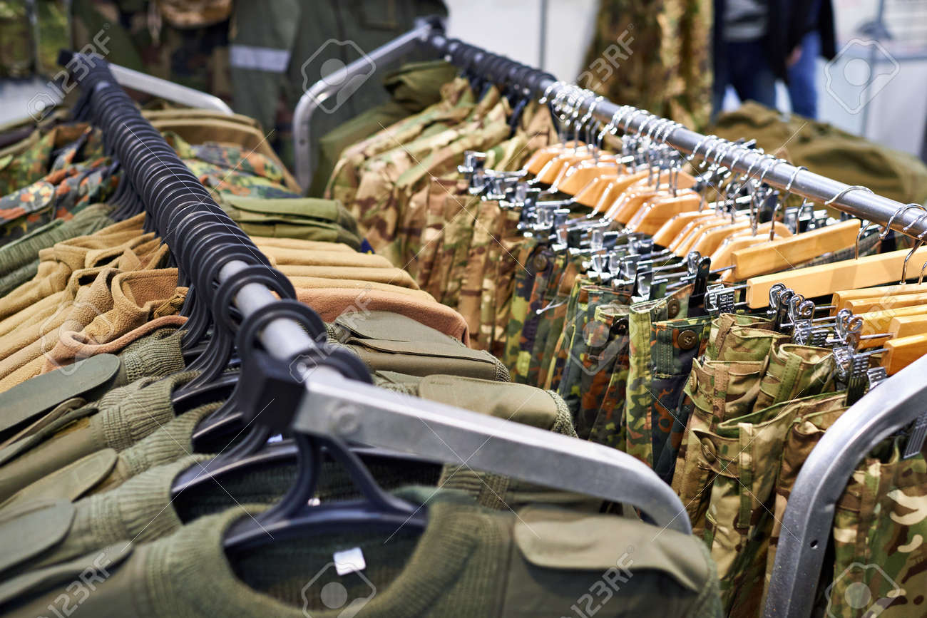 03b25967a2022 Clothing for hunting and fishing on the hanger in the store Stock Photo -  76459915