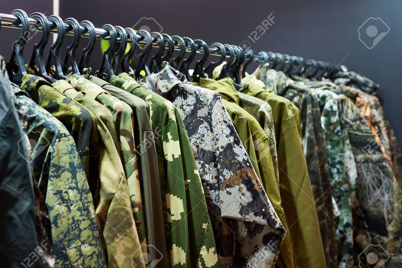 fd12332da0374 Jackets for hunting and fishing on the hanger in the store Stock Photo -  76459943