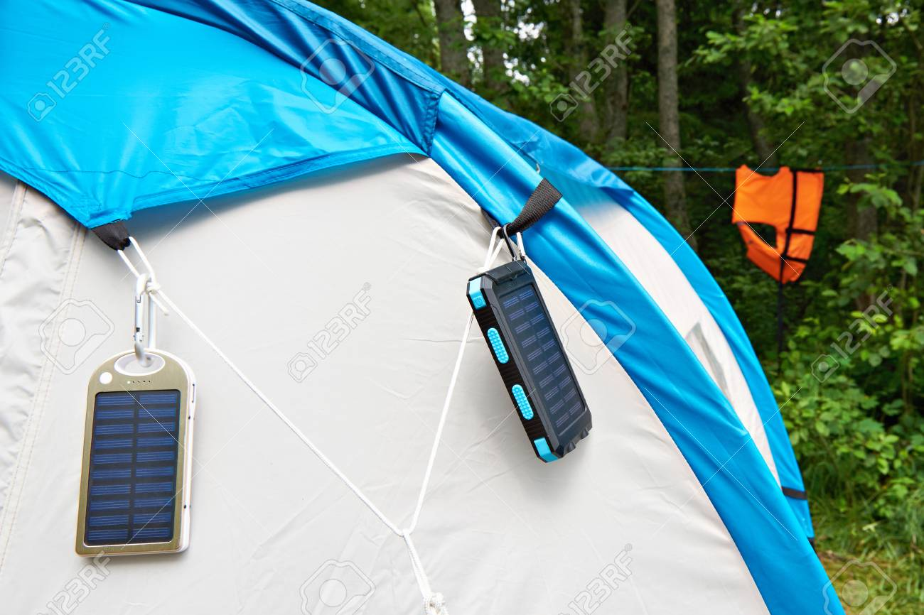 Hiking hand-held portable batteries with solar panels on tent Stock Photo - 86468853 & Hiking Hand-held Portable Batteries With Solar Panels On Tent Stock ...