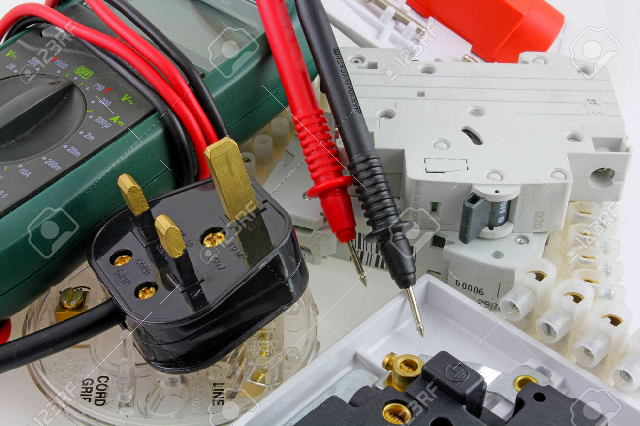 Plan view of electricians testing multimeter equipment - Various