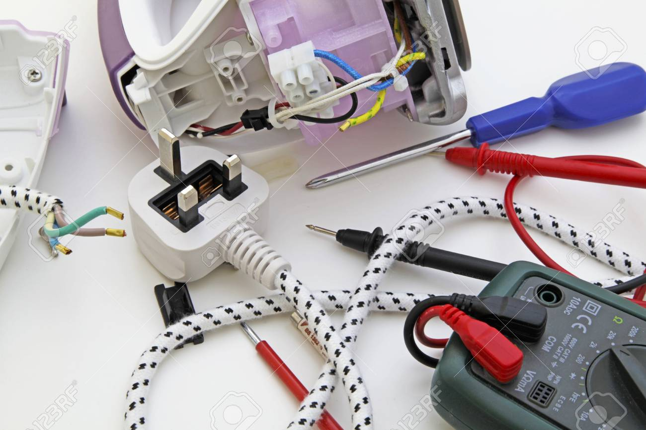 Appliance Testing – An Appliance Engineer Repairing An Electric Iron.  Stock Photo, Picture And Royalty Free Image. Image 92511311.