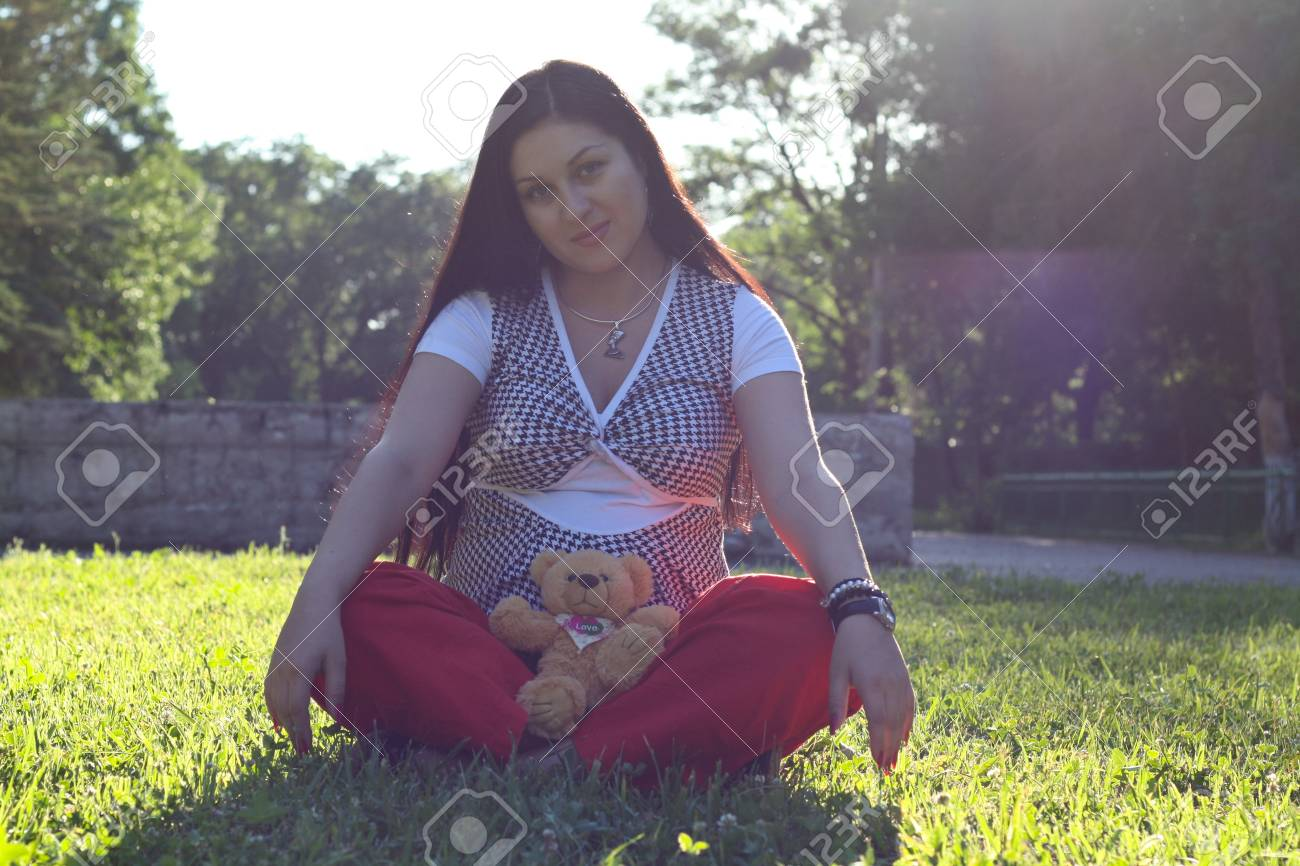 The young pregnant girl walks in park Stock Photo - 14300014
