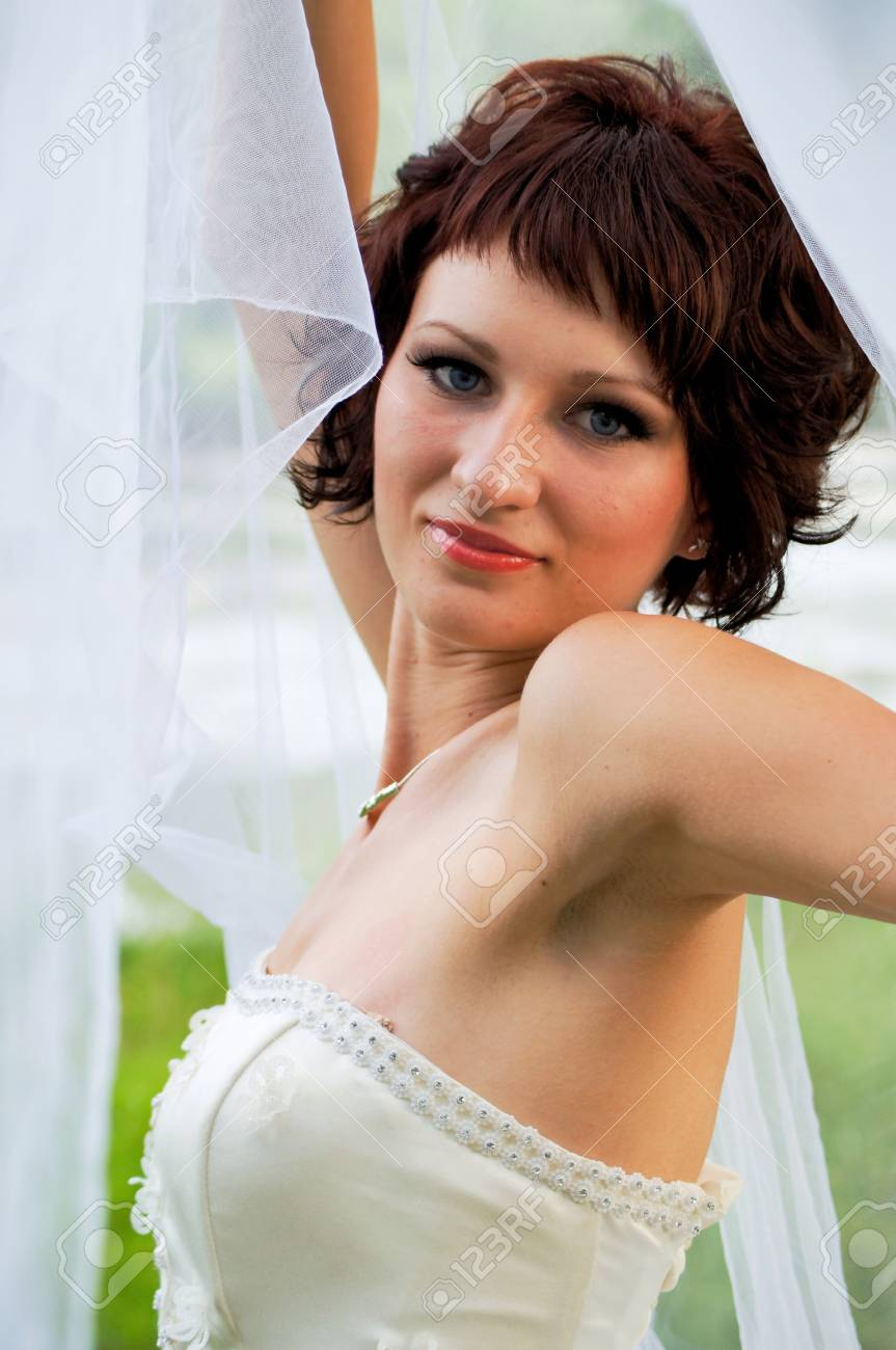 Pretty girl in a wedding dress Stock Photo - 18333891