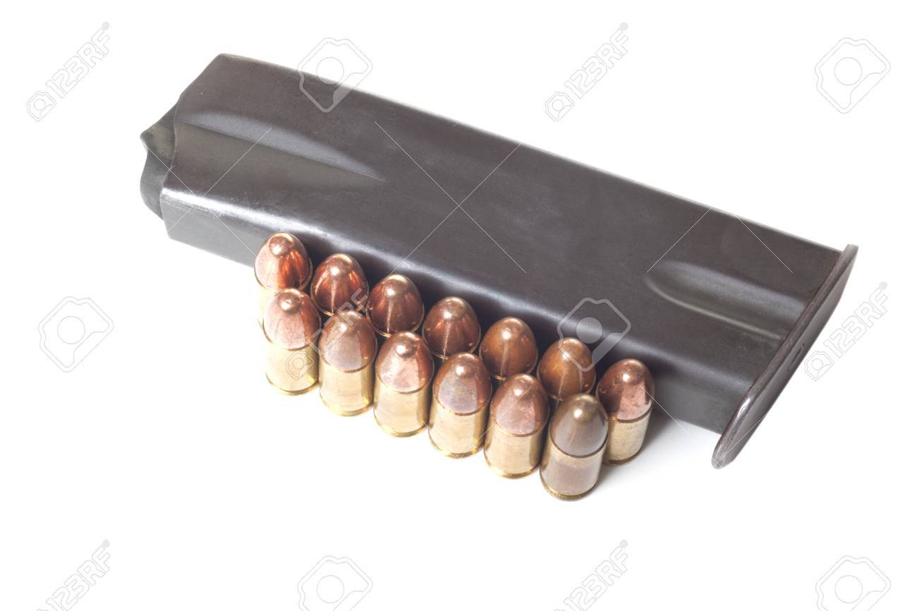 Two rows of 9mm bullets and gun holder isolated on white background Stock Photo - 16949692