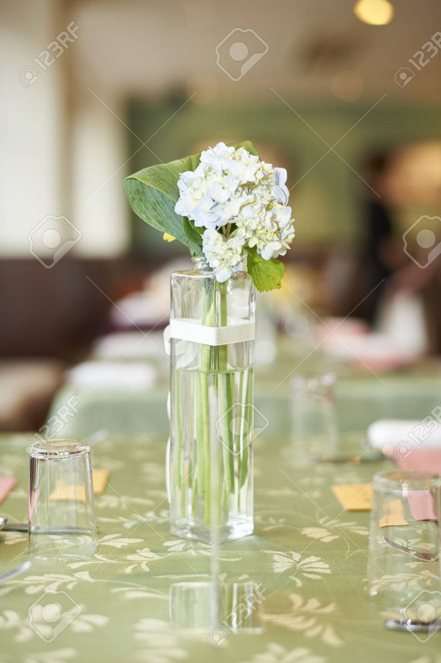 A Small Glass Vase Of White Flowers On A Green Table At A Wedding Stock Photo Picture And Royalty Free Image Image 60342460