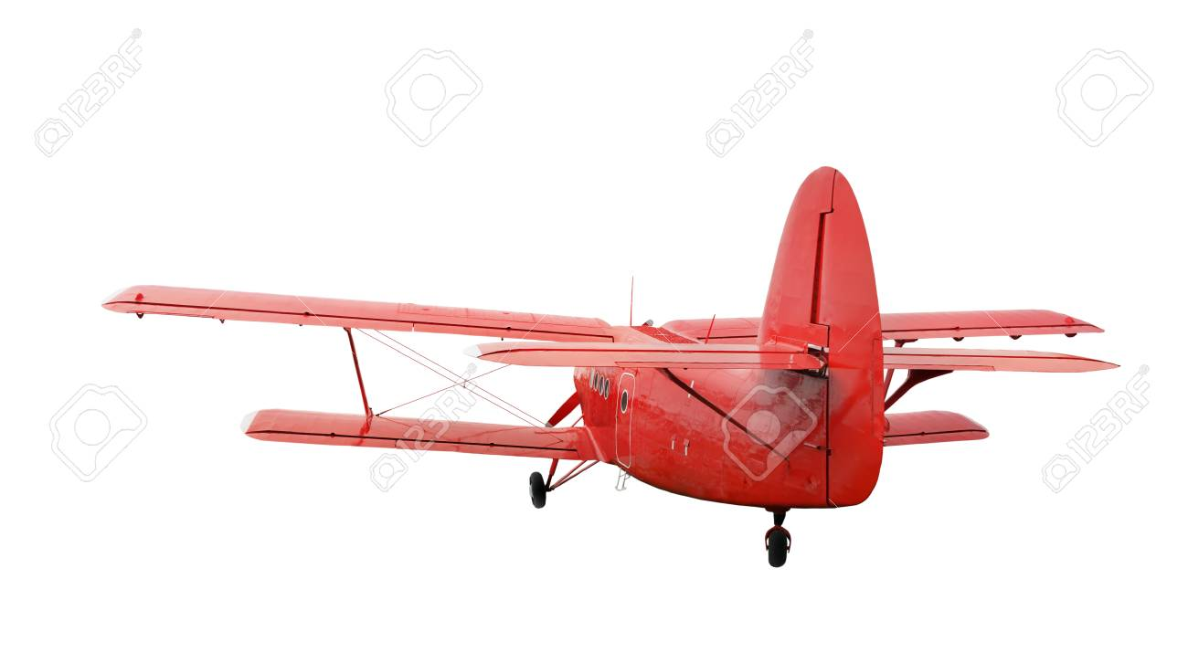 Back side view of red airplane biplane with piston engine and
