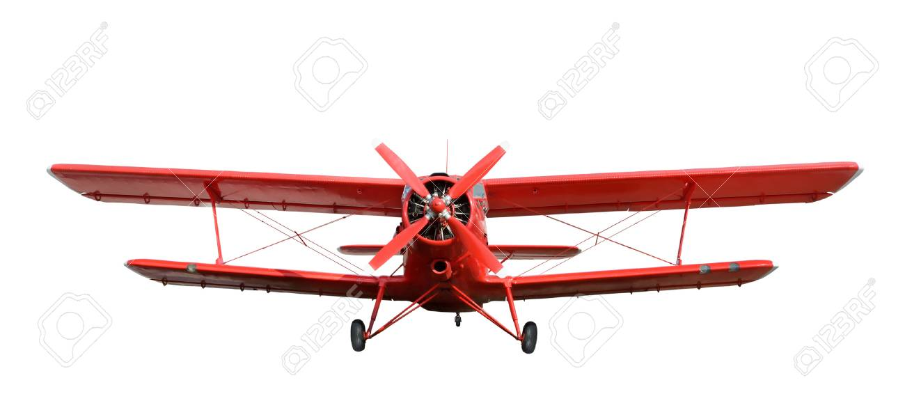 Front view of red airplane biplane with piston engine and propeller
