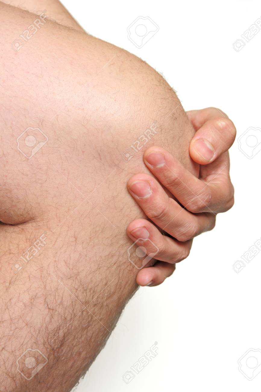 male knee with hand Stock Photo - 13416727