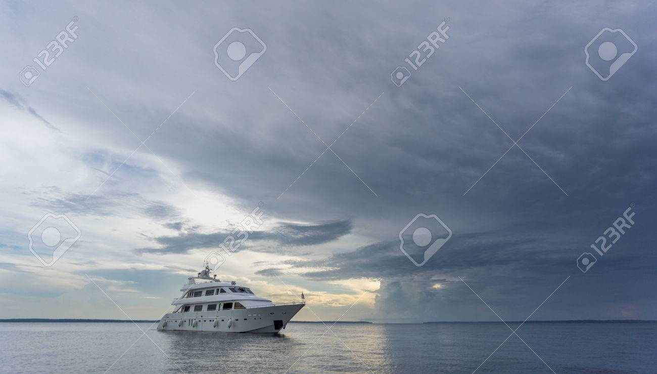 boat entering storm with calm water stock photo picture and royalty