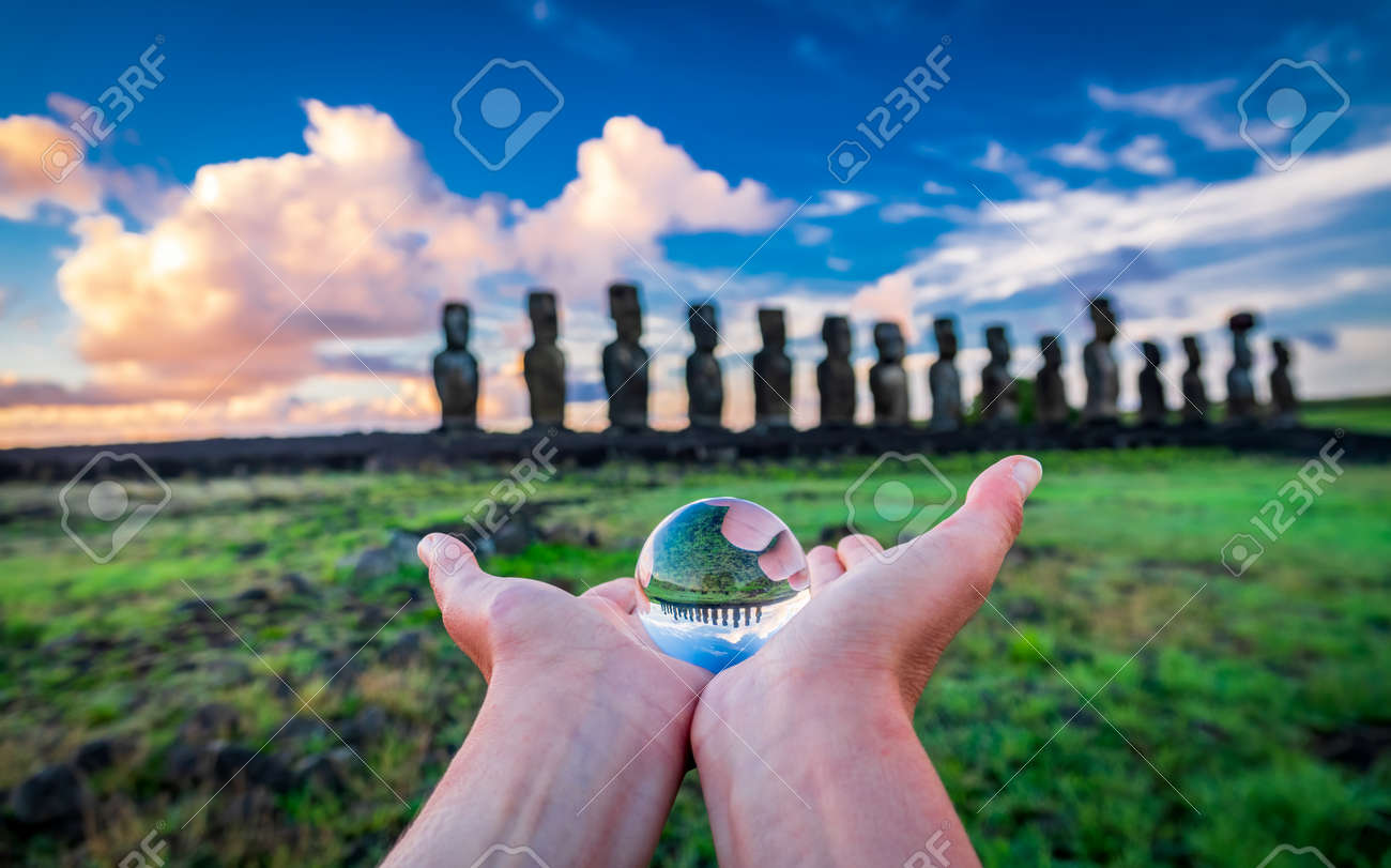 Offering crystal ball to moai platform at dawn - 151573709