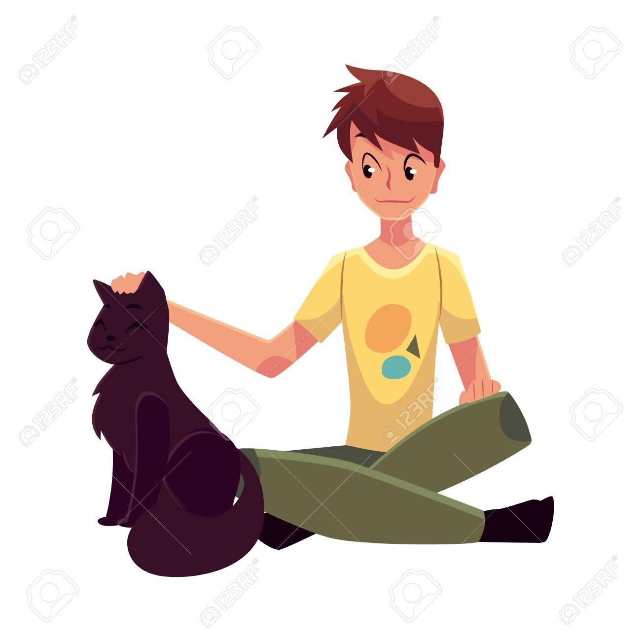 Un Adolescent Assis Sur Le Sol Et De Caresser Un Gros Chat Noir