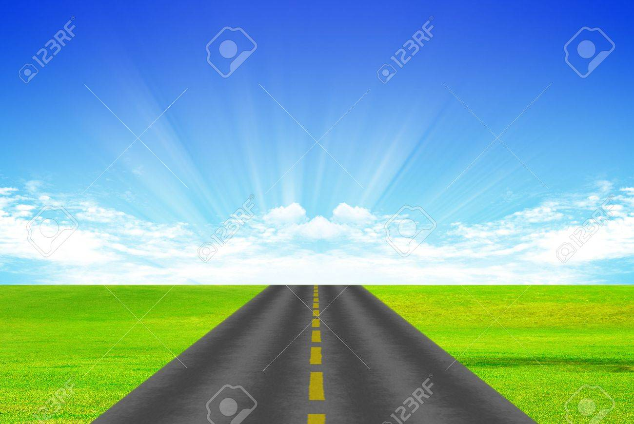 Road with yellow dividing stripon background of green grass and blue sky Stock Photo - 5164198