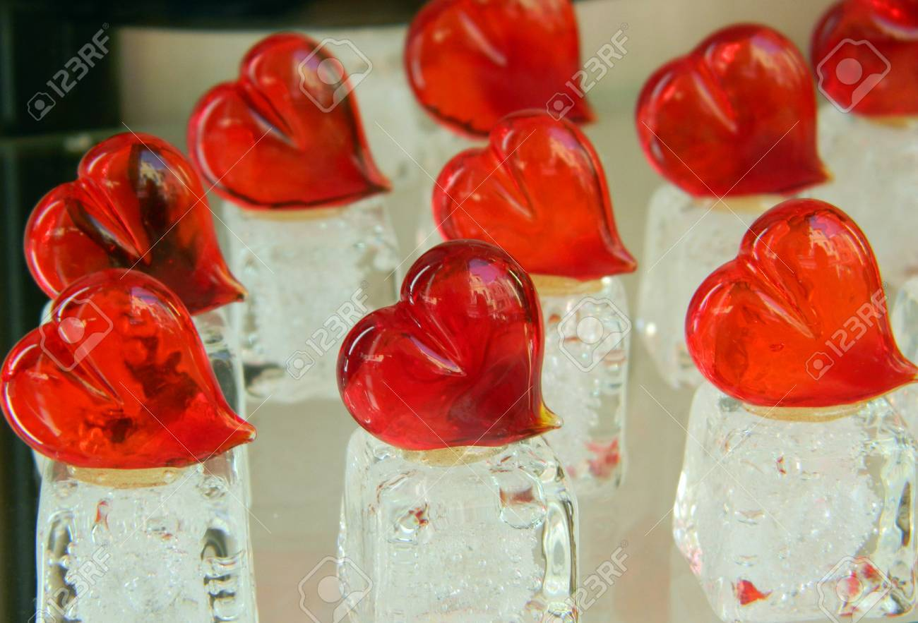 Valentines day hearts made of Murano glass, on white, ice like support. Stock Photo - 51796316
