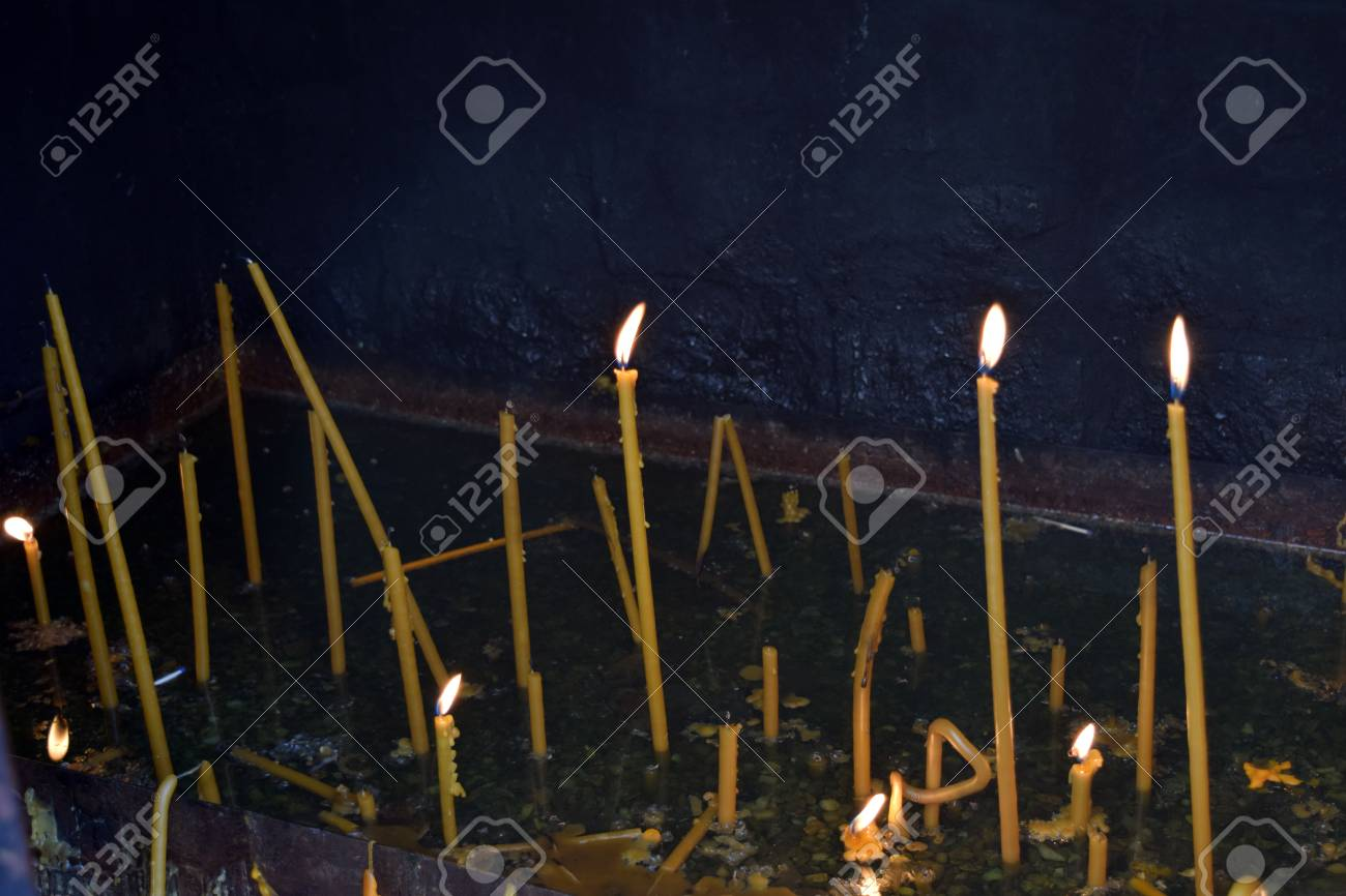 Monastery burning candles for the living and for the dead. Stock Photo - 52519298
