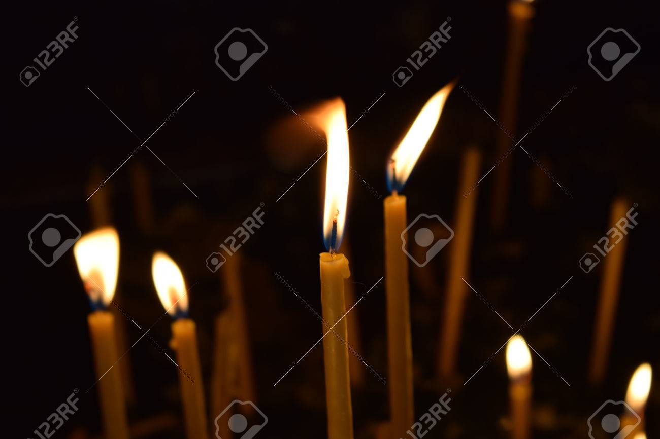 Monastery burning candles for the living and for the dead. Stock Photo - 52519306