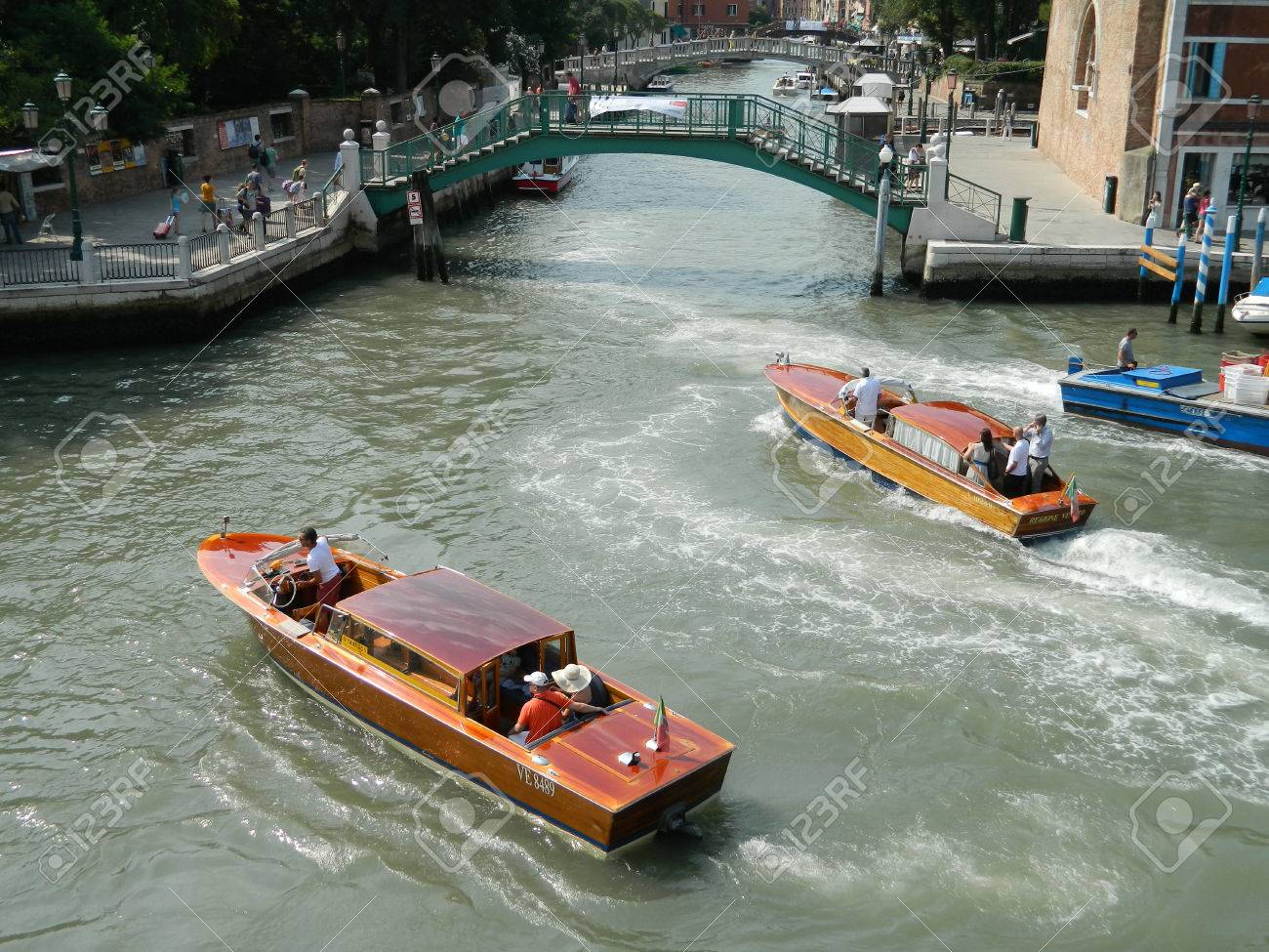 VENICE, ITALY - 6 JULY 2015 Wooden Venice taxi motorboat with passengers water taxi in Grand Canal Stock Photo - 55334615